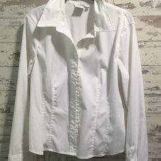 Blouse from Steinmart Como stretch is the brand. Love it. Gotten snug thru the waist line. I have looked it over and do not see any stains or spots. Tops Blouses