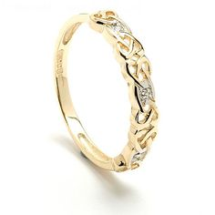 When you see the intricate, openwork Celtic knot pattern that forms this elegant Celtic wedding ring, it is clearly the work of a true craftsman. To complement the design, the ring is set with three sparkling diamonds. It is available 14k rich yellow, or cool white gold. The name Sibeal is a form of Isabel which is also an anagram. It is the Spanish form of the Hebrew name Elisheba, meaning God is my oath.  Net Weight: 1.8 grams Width: 3mm Diamond Cut: Single Cut Diamond Color: I/J Diamond…