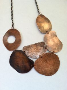 Hand cut copper bib necklace. www.seladesigns.etsy.com ALL PROFIT is donated to charity.
