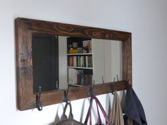 Beautiful, functional and sturdy rustic mirror with five antique hooks for coats, handbags, keys etc. It is perfect for your entryway and it