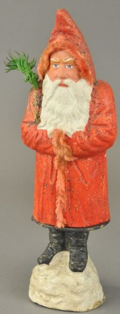 GERMAN BELSNICKLE CANDY CONTAINER for auction. Standing on snow mound, this composition Father Christmas wears a red fur trimmed robe, feather tree sprig in arm and has a rather stern facial expression. German Christmas, Old Fashioned Christmas, Christmas Mood, Antique Christmas, Primitive Christmas, Father Christmas, Christmas Items, Christmas Candy, Blown Glass Christmas Ornaments