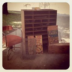 Flea Market Haul: Texas Yard-Sale Buys.  I love this office cubby unit with the old wire baskets!