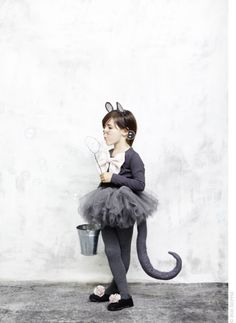 Child disguised as mouse. Both child and mouse are disgusting.