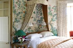 A feminine  guest bedroom is decorated with a contemporary Chinese wallpaper ~ Tino Zervudachi, Sologne, France