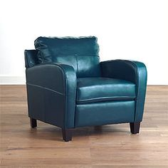 Peacock or teal blue leather chair.