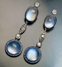 Antique Moonstone, Sapphire and Diamond Pendant Earrings, Circa 1915. Silver topped 14K gold, cabochon cut blue moonstones, calibre cut blue sapphires, old cut diamonds