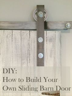 Learn how to make your own sliding barn door. All I did was buy a old door from an antique show and made the track for $50. http://sweetmapleblog.com/2014/09/15/diy-how-to-make-your-own-sliding-barn-door/ #DIY