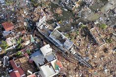 An aerial view of devastation and a ship after it was swept at the height of super typhoon Yolanda in Tacloban last Friday in this handout provided by Philippine Air Force. Philippine Air Force, Abandoned Ships, Papa Francisco, Natural Disasters, Aerial View, In The Heights, Philippines, City Photo, Photos