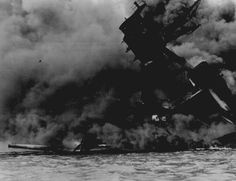 """The USS ARIZONA burning after the Japanese attack on Pearl Harbor."" December 7, 1941"