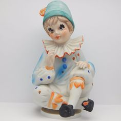 "SOLD - Vintage collectible pre-owned rotating bisque porcelain ceramic musical clown figurine.  A seated clown is dressed in a polka dotted outfit with ruffled collar, jester shoes, and hat with flower.  When the base is wound up the figurine rotates and an internal music box plays ""Send In The Clowns"". #Vintage #Clown #MusicBox #Figurine"