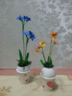 Flower in egg. Clay craft.
