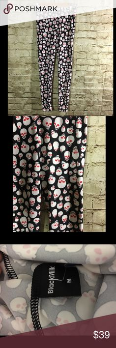 """Black Milk Skulls Black Red Leggings Blackmilk Name Brand: Blackmilk Condition: Pre Own, Excellent Condition, No flaws to note. Never Worn  Size: Medium (see measurements)  Color: Black with white skulls and red eyes   Style: Leggings  Material: 100% Polyester  Always check the measurements, label sizes are not consistent.   Measurements are approx and are of item laying flat and unstreched: Waist:13 """" Rise: 9"""" Inseam: 30"""" Length: 35.5"""" Blackmilk Pants Leggings"""