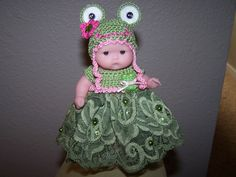 # 623 Beautiful green lace with a matching frog hat.
