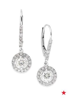 Sure to add some sparkle to your bridal look, these exquisite drop earrings with diamonds in white gold.