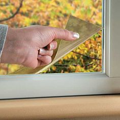 Self-Adhesive Energy Window Film. Reflects over 60% of solar heat in summer. keep home heat from escaping in winter. The mirrored glare shield finish also provides privacy; you can see out, but others cant see in.And while other window films darken a room and make it dreary, Self-Adhesive Energy Window Film provides 75% light transmission.