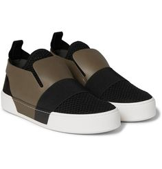 A slick alternative to ubiquitous lace-up sneakers, Balenciaga's slip-on pair is made from a mix of mesh, suede and leather for a cool textural contrast. The pliable honeycomb panels and elasticated straps ensure comfort and breathability, while the robust army-green leather uppers provide structure and support the ankles. Complement their urban look by teaming them with distressed denim.