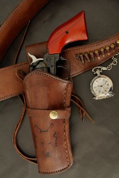 Heritage Rough Rider Single Action Revolver. Bull creek leather holster and gun belt. Pocket watch.