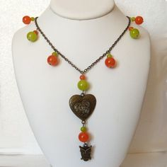 Beaded long necklace with owl charm and glass beads by CapricesDeParisienne on Etsy