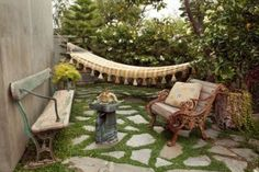 Amazing how nature and shabby, antique benches blend on this beautiful backyard.