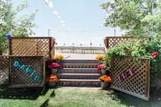 Fiesta deck, terracotta tiles and flowers in buckets