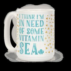 """Suns out buns out. Show your love for sea and surf with this fun mermaid beach design. This summer vacation coffee mug features the phrase """"I think I'm in need of some vitamin SEA"""" small faux gold... 
