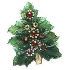 Stanley Hagler Christmas Tree Brooch on the cover of Christmas Tree Pins by Nancy Yunker Trowbridge