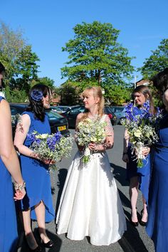 Bride with bridesmaids and bouquets.