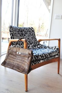 Madeline Weinrib Black Luce Ikat Fabric upholstered chair in the home of Athena Calderone via Tales of Endearment