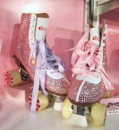 Crystallized roller skates with satin ribbon laces and crystals on the wheels too...so cute!