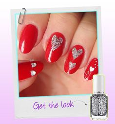 Valentine's Day manis;  his lovely-dovey mani takes a classic approach to Valentine's Day. To create the silver hearts in this design, nail artist Maryam Maquillage used simple Scotch tape and scissors to create stencils. (Check out the full tutorial on how to do it here.)