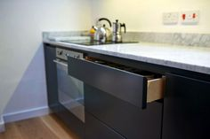 Contemporary dark grey kitchen with soft close drawer https://www.bathbespoke.co.uk/kitchens/