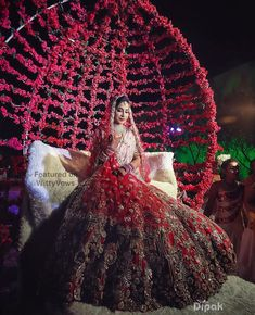 Trending new ideas for bride's entry | Fab bridal entry ideas | Beautiful Indian brides | Bride in Red Lehenga | Bride entering on a carriage adorned with red roses | Bridal photos | Indian wedding photography | Picture Credits: Dipak Studios | Every Indian bride's Fav. Wedding E-magazine to read.Here for any marriage advice you need | www.wittyvows.com shares things no one tells brides, covers real weddings, ideas, inspirations, design trends and the right vendors, candid photographers etc.