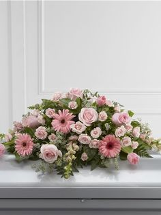 Casket spray for a women with pink flowers