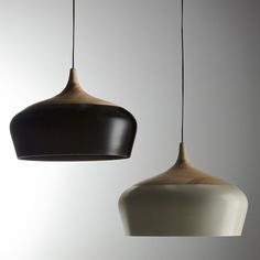 Coco Pendant by Kate Stokes, available through Matilda Design. Handcrafted from turned timber and powder-coated spun aluminium. The smooth timber surface gives way to the aluminium shade, creating a delicate contrast between these two very different materials. #lighting