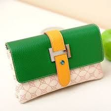 #LadiesWallets are flat foldable cases made from leather or fabric used for carrying currency and other personal valuables - http://www.shriexports.net/ladies-wallet/