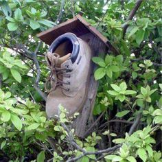 I saw this on a page called Different Solutions...this would be perfect in my opinion for a blue bird house. Untie the laces and you could clean it out every year.