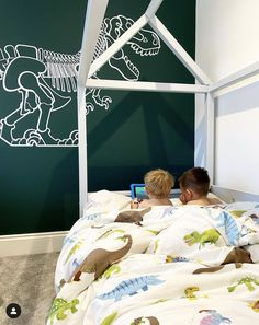 Large White T-Rex Dinosaur Wall Decal applied on a beautiful dark green wall - Designed by Glue Studio.