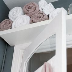great idea for towel storage in a tight space. When we move in this may be one of the first projects I do... very small linen closet that would be better served for bed linens and keeping cat food away from the cats