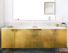 brass sheets brass cabinets in white bathroom-love the look, just don't know how you'd keep it clean looking