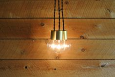 Very simple pendant cluster with exposed globe bulbs and contrasting brass socket covers. We can also make these to hang at the same length or