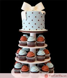Baby Boy's Christening Cupcake Tower by Pink Cake Box in Denville, NJ.  More photos and videos at http://blog.pinkcakebox.com/baby-boys-christening-cupcake-tower-2012-03-24.htm