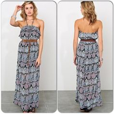 """Strapless Paisley Print Maxi Dress This strapless woven maxi dress features an elastic bust line with a flouncy overlay. Accentuated waist with belted detail. Floral paisley print throughout. Flared hemline with raw stitching. Lined. Lightweight. 100% rayon. MEDIUM fits bust 34""""-36"""", waist 30""""-32"""", hips 36""""-38"""". LARGE fits bust 36""""-39"""", waist 32""""-34"""", hips 38""""-41"""". Medium measures 48"""" top to bottom. Large measures 51"""" top to bottom. strapless dress Dresses Maxi"""
