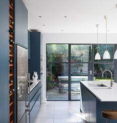 Slot House by AU Architects remodels a London end of-terrace house through the introduction of natural light, volume and the visual connection of new spaces with the existing. AUA has remodelled an end of terraced house to provide a greater and more free flowing accommodation for a family. The design brief was one of simplicity …