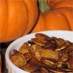 Spiced Pumpkin Seeds. Made these but added a few drops of hot sauce - excellent