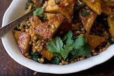 Orange Pan-glazed Tempeh          Produce      Cilantro (1 handful)      Coriander, ground (1/2 teaspoon)      Ginger (1 tablespoon)      Lime (1/2)      Tempeh (10 ounces)        Condiments      Mirin (1 1/2 tablespoons)      Tamari (2 teaspoons)        Cooking & Baking      Garlic cloves, small (2)      Maple syrup (2 teaspoons)      Olive oil (2 tablespoons)        Drinks      Orange juice, freshly squeezed (1 cup)