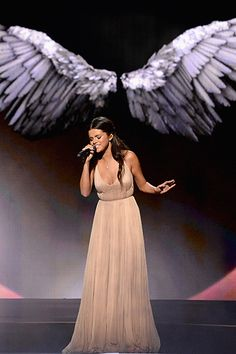 """Selena Gomez performs """"The Heart Wants What It Wants"""" onstage at the 2014 American Music Awards"""
