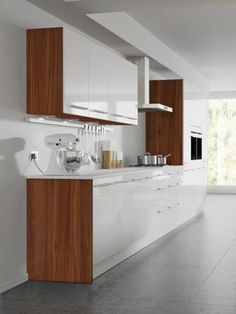 Four Seasons kitchen cabinets - mix and match options. Aspen white gloss door with natural walnut kitchen cabinet.