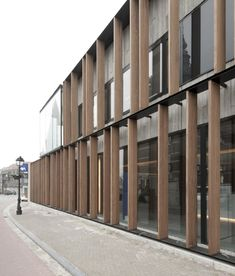 Office Solvas / GRAUX & BAEYENS architecten (3)Belgium  A rhythm of wooden slats creates a privacy filter without compromising daylight, as well as a visually open fence for the patio facing the street.  Article: Arch Daily:   Filed under: Featured ,Institutional Architecture ,Selected , Belgium, GRAUX & BAEYENS architecten, Zomergem