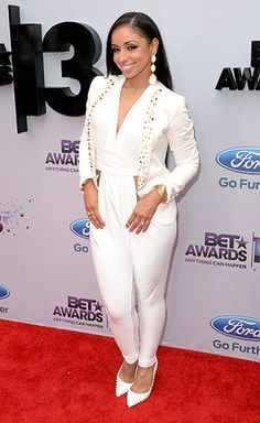 Mya  The singer selected a white and gold look.