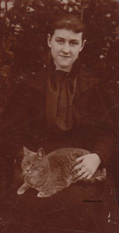 vintagetails:    Vintage cat and lady  Found photo with no ID.